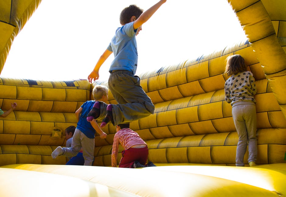 kids jumping on inflatable bouncy castle